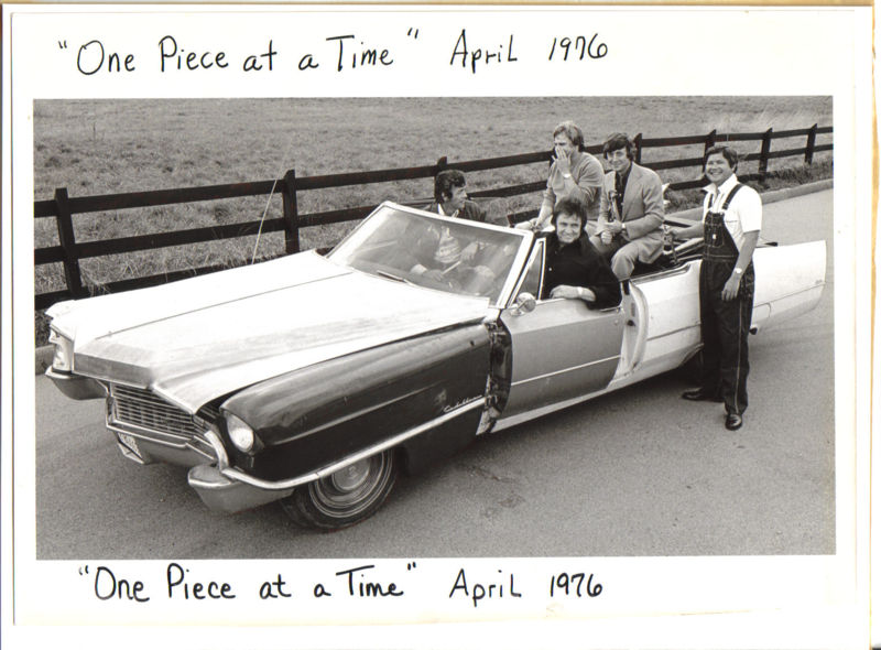 "Johnny Cash in the driver's seat of the ""One Piece At a Time"" Cadillac with Bruce Fitzpatrick standing at the far right."